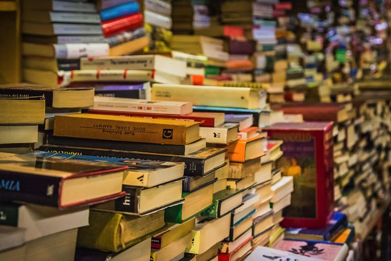 Picture of piles of books in a bookstore